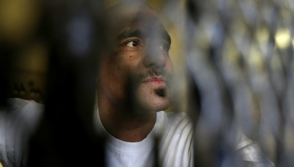 Condemned inmate Martin Navarette peers out his cell on death row at San Quentin State Prison near San Francisco, in December 2015. (AP Photo/Ben Margot)