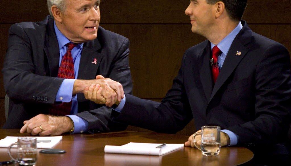 Democrat Tom Barrett and Republican Scott Walker at a recent debate