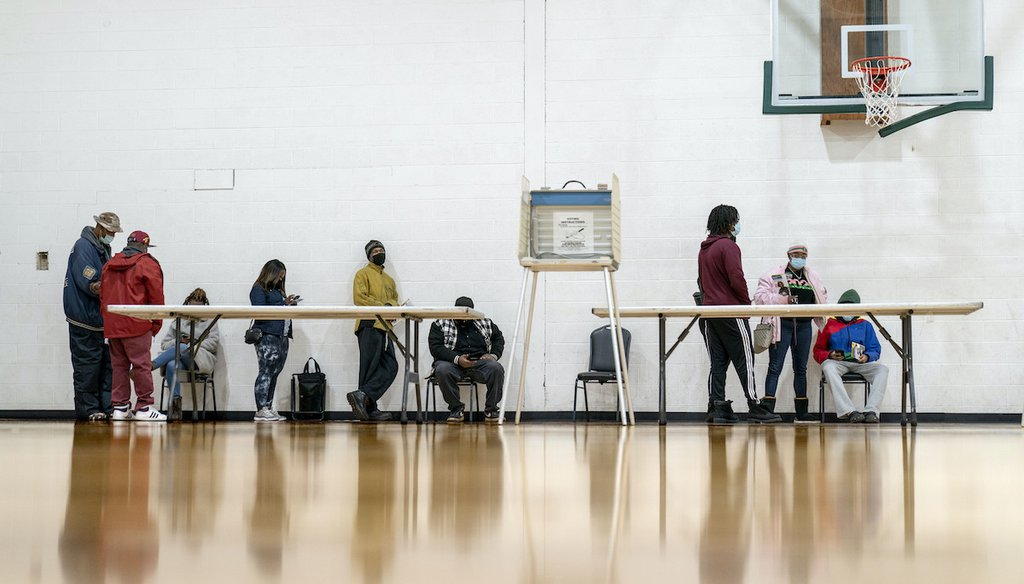 Voters wait in line to fill out a ballot on the last day of early absentee voting before the general election at the Northwest Activities Center in Detroit, Monday, Nov. 2, 2020. (AP)