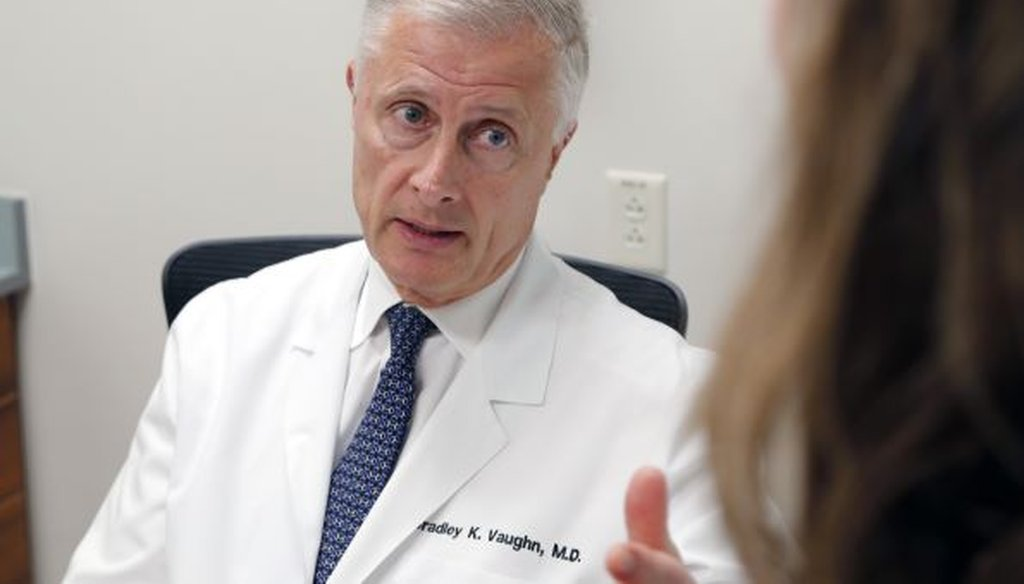 Knee and hip surgeon Bradley Vaughn consults with patient Quay Garriga, who had both hips replaced by him, during a visit to his offices in Raleigh, NC, on Sept. 21, 2017. (News & Observer)