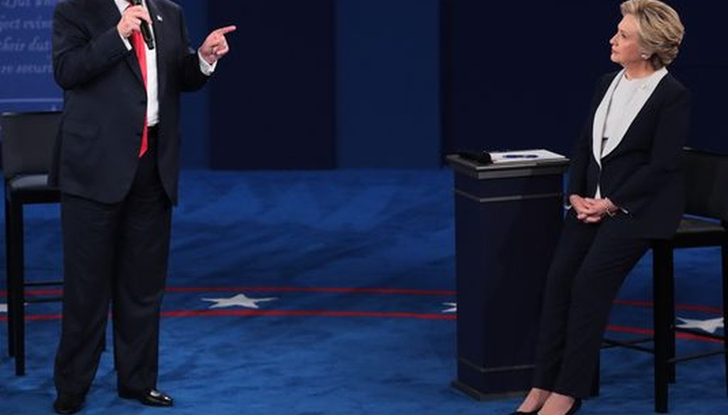 Donald Trump and Hillary Clinton, shown here at a presidential debate in St. Louis on Oct. 9, 2016, were a dominant presence in PolitiFact Wisconsin's most-clicked items in 2016. (Getty Images)