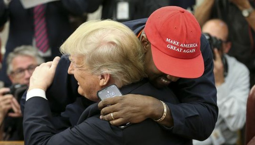 Kanye West embraces President Donald Trump in the Oval Office during a visit on Oct. 11, 2018. (Getty Images)