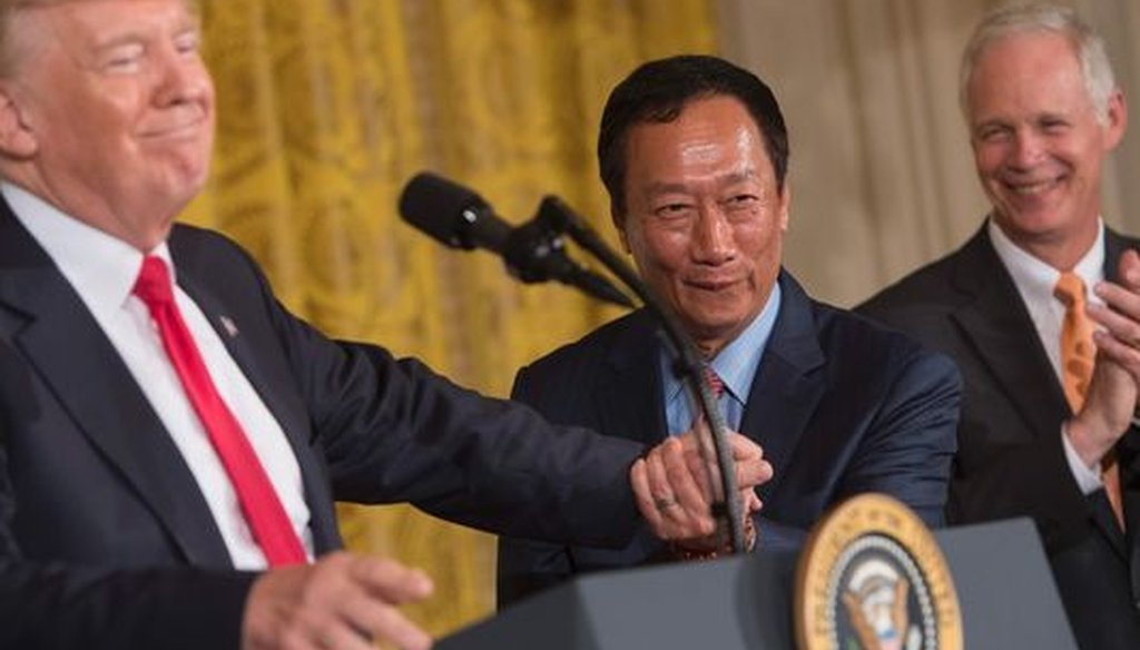President Donald Trump (from left), Foxconn chairman Terry Gou and Wisconsin U.S. Sen. Ron Johnson appeared at the White House to announce Foxconn's plans to build in Wisconsin. (Getty Images)
