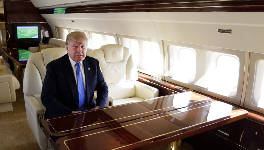 Republican presidential front runner Donald Trump rests inside his plane before addressing a campaign rally on March 29, 2016 in Janesville, Wis. (Rick Wood photo)