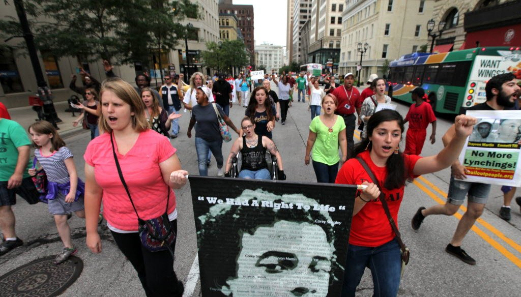 Demonstrators marched in downtown Milwaukee on Aug. 25, 2014 to raise awareness about the fatal police shootings of Dontre Hamilton in Milwaukee and Michael Brown in Ferguson, Mo.