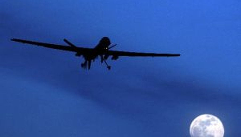 An unmanned United States Predator drone flies over Kandahar Air Field in Afghanistan on a moon-lit night in a Jan. 31, 2010, file photo.