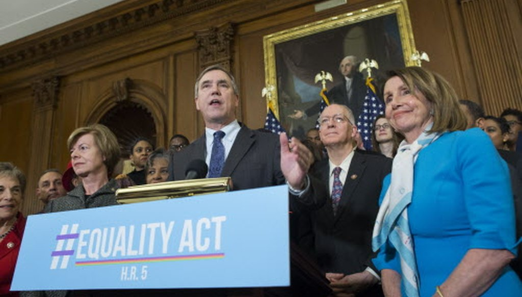 Oregon Sen. Jeff Merkley (center) comments during an event to introduce the Equality Act March 13, 2019 in Washington. Also attending is Wisconsin Sen. Tammy Baldwin (left) and House Speaker Nancy  Pelosi. (Michael Reynolds)