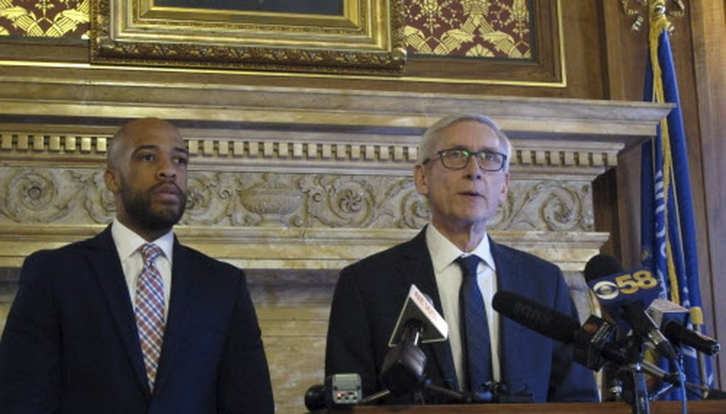 Gov. Tony Evers (right) says he told told Republican lawmakers that he will push for Medicaid expansion, but won't propose eliminating the state's economic development agency Jan. 15, 2019, in Madison. At left is Lt. Gov. Mandela Barnes. /Associated Press