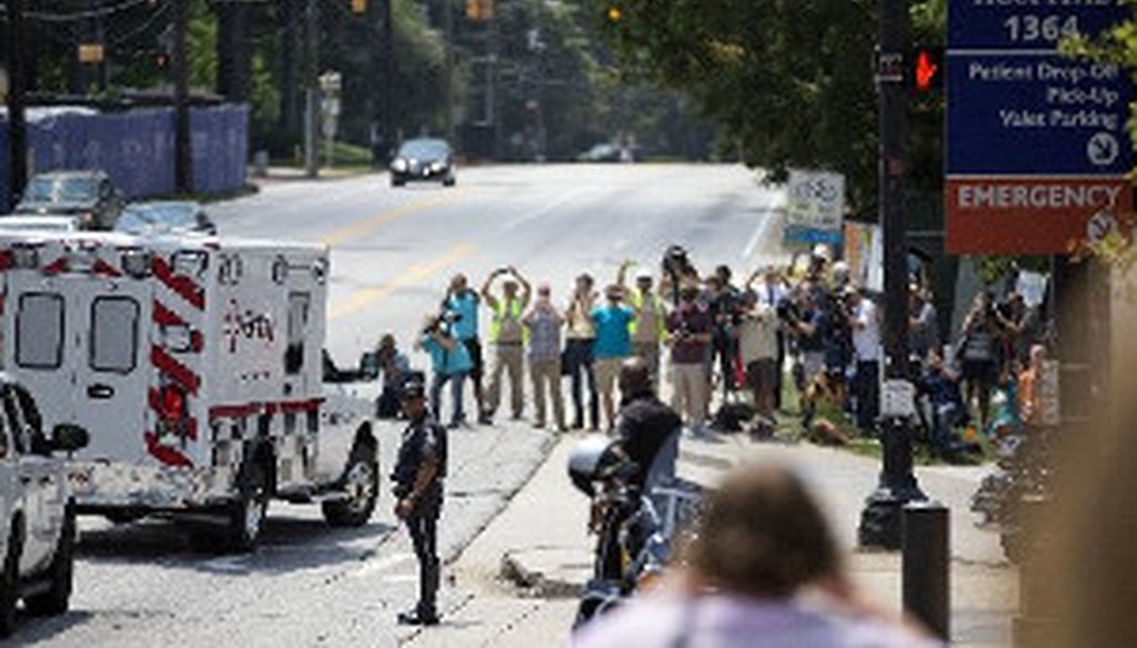 An ambulance transporting Nancy Writebol, an American missionary stricken with Ebola, arrives at Emory University Hospital, Tuesday, Aug. 5, 2014, in Atlanta. She joins another U.S. aid worker, Dr. Kent Brantly, in a special isolation unit. (AP Photo)