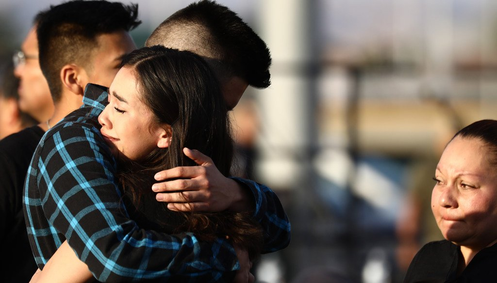 Mourners embrace at a vigil honoring Horizon High School sophomore Javier Amir Rodriguez, who lost his life in a mass shooting in nearby El Paso, on August 5, 2019 in Horizon City, Texas. (Photo by Mario Tama/Getty Images)