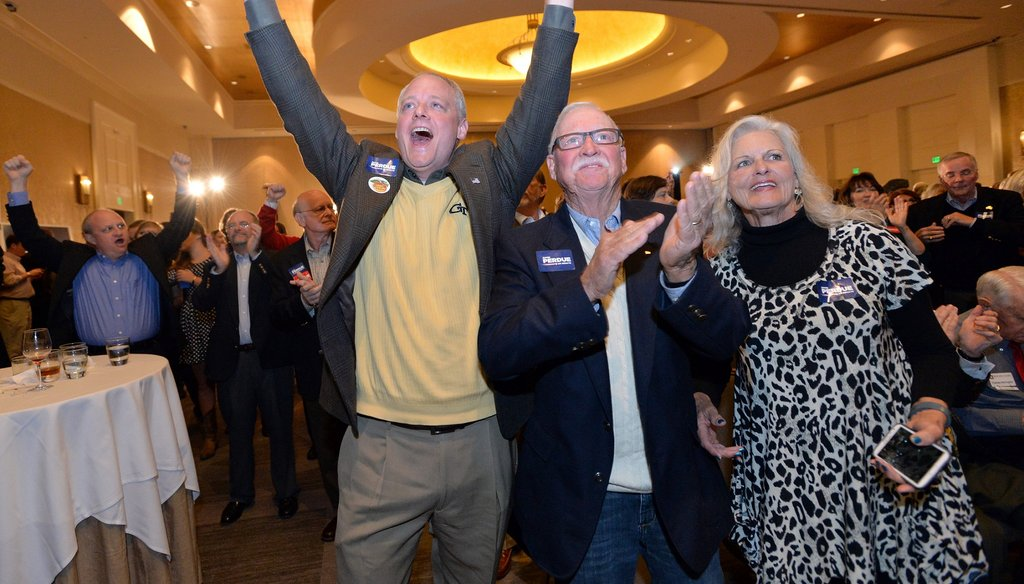 Supporters of GOP candidate for U.S. Senate David Perdue celebrate his victory Tuesday night at a party at the InterContinental  Buckhead in Atlanta. Photo by Hyosub Shin / AJC.