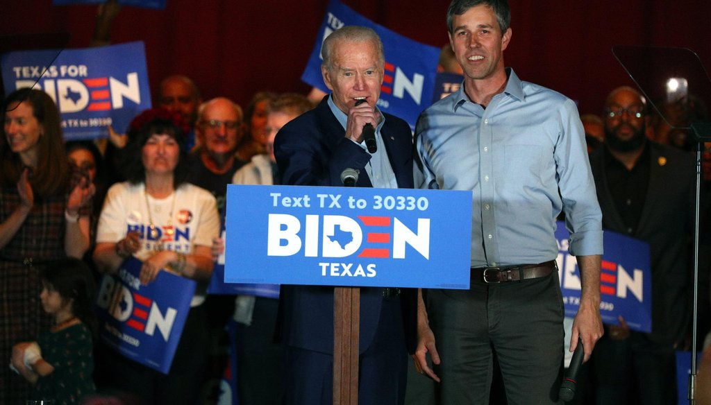 Democratic presidential candidate Joe Biden speaks with Democrat Beto O'Rourke at a rally in Dallas ahead of Super Tuesday (AP Photo/Richard W. Rodriguez).