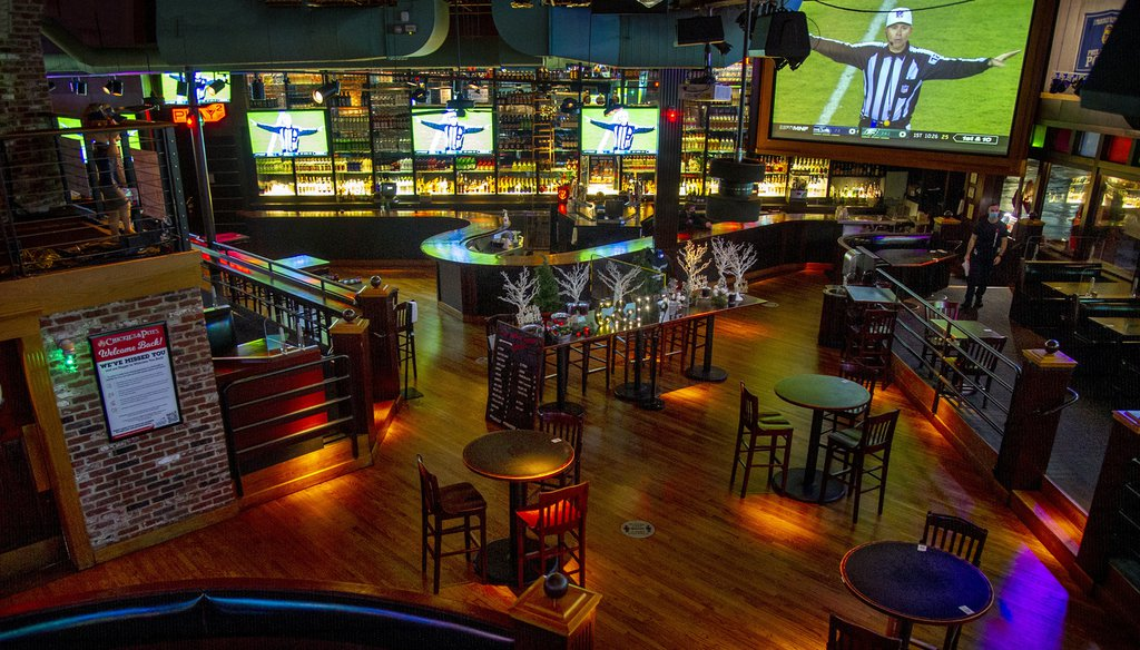 The normally packed Chickie & Pete's sports bar and restaurant in South Philadelphia is empty during the Eagles Monday Night Football game, since the city instituted ban on indoor dining. TOM GRALISH / Inquirer Staff Photographer