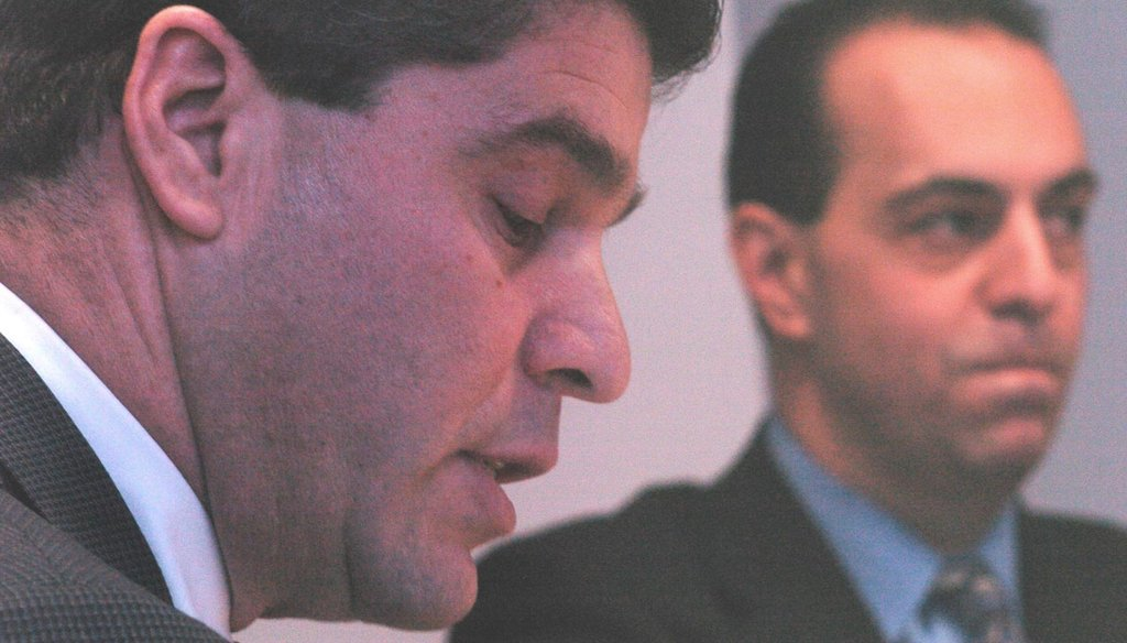 Ernest Almonte (left) when he was Rhode Island's auditor general during a March 2004 meeting with North Providence officials on the town's financial problems. Then-Mayor Ralph Mollis listens in the background. (The Providence Journal / Bob Thayer)