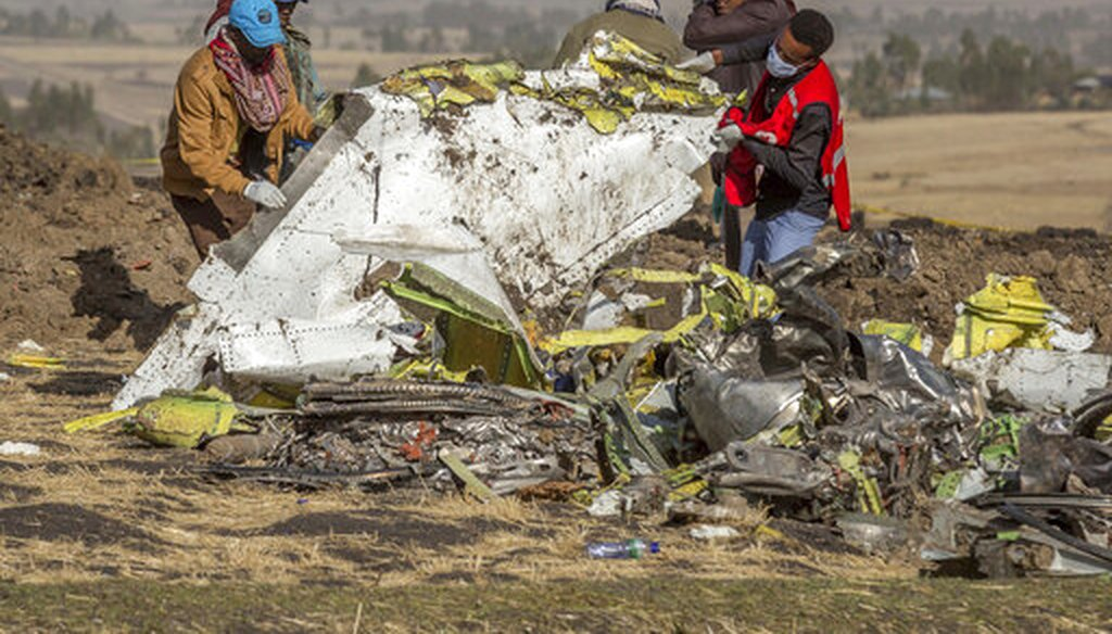 Rescuers work at the scene of an Ethiopian Airlines flight crash south of Addis Ababa, Ethiopia.  (AP Photo/Mulugeta Ayene)
