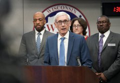 Checking Evers' promises on Act 10, prisons, commissions