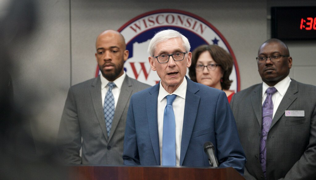 In this March 12, 2020 file photo, Gov. Tony Evers declares a public health emergency in Madison, Wis. Evers has ordered a ban on all gatherings of more than 50 people (Steve Apps/Wisconsin State Journal via AP)