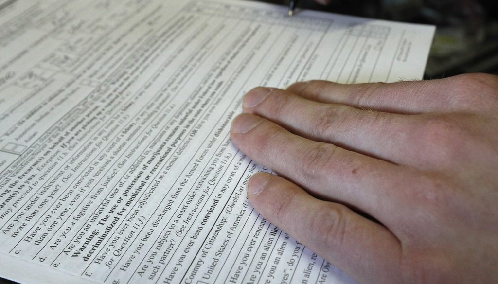 Filling out a federal form is part of the background check process. Since the February 2018 Florida school shooting that killed 17 people, some politicians are calling for a law requiring background checks on all gun purchases. (Getty Images)