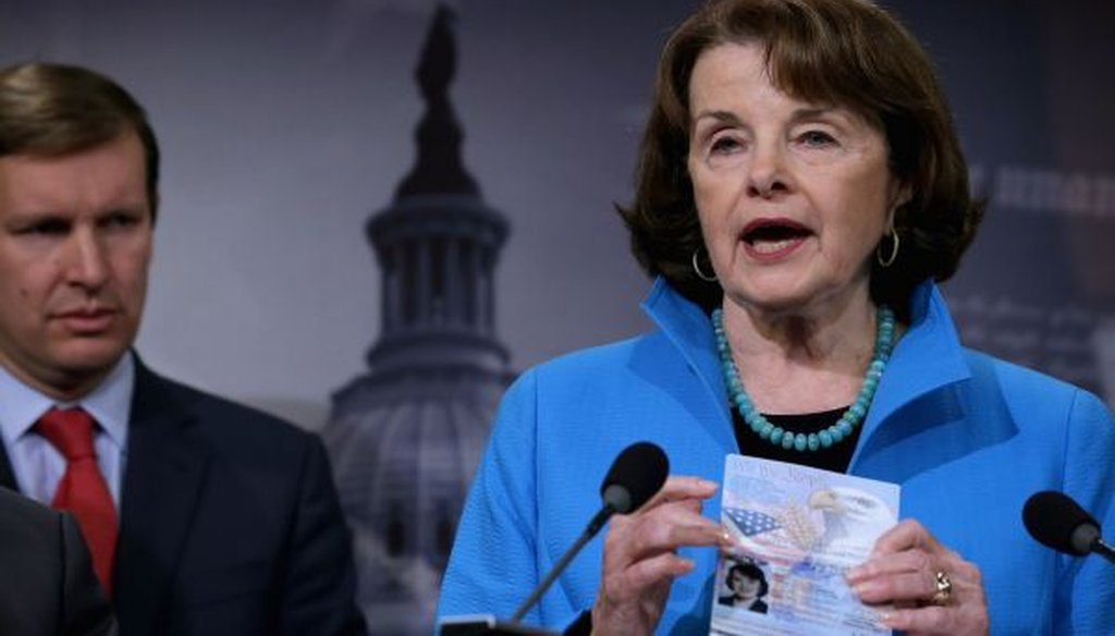 Senate Intelligence ranking member Dianne Feinstein, D-Calif., holds up her passport during a news conference at the Capitol on Nov. 19, 2015. (Chip Somodevilla/Getty Images)