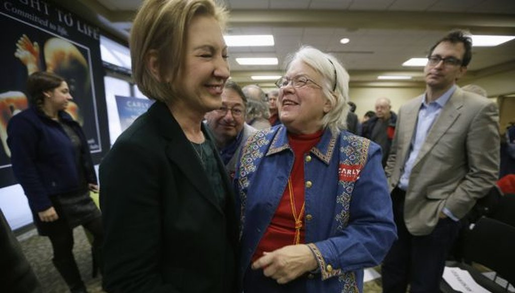 Republican presidential candidate Carly Fiorina laughs with Lynn Seydel of Ames, Iowa, right, during the Iowa Right to Life Presidential Forum on Jan. 20, 2016, in Des Moines, Iowa. (AP/Charlie Neibergall)