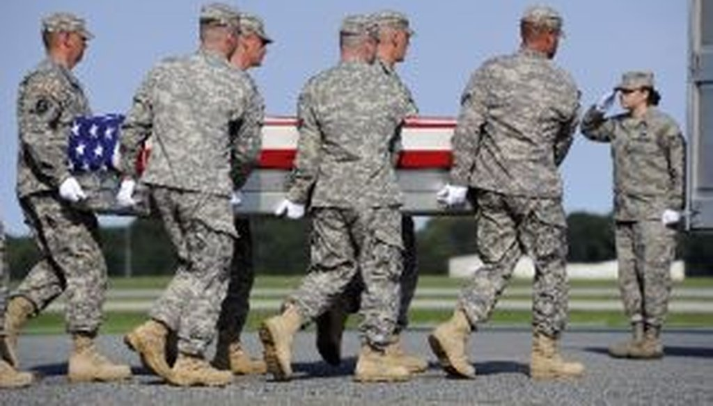 An Army team carries a transfer case containing the remains of Army Sgt. Devin Daniels, of Kuna, Idaho, who died in Afghanistan.