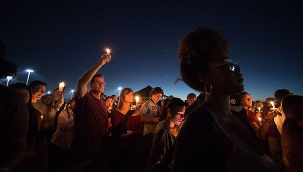 A candlelight vigil was held the day after the mass shooting at a Florida high school. (USA Today Network)