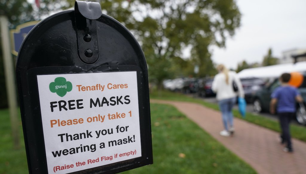 A mailbox containing free masks for pedestrians stands in the center of Tenafly, N.J., on Oct. 22, 2020.