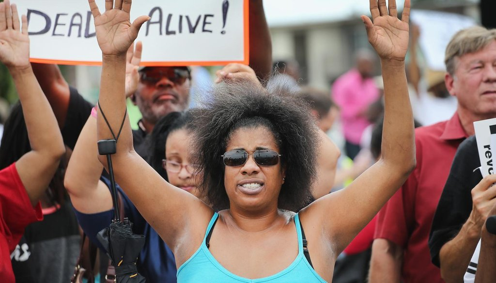 Demonstrators protest near a ramp which leads onto Interstate Highway 70 on Sept. 10, 2014 near Ferguson, Mo.
