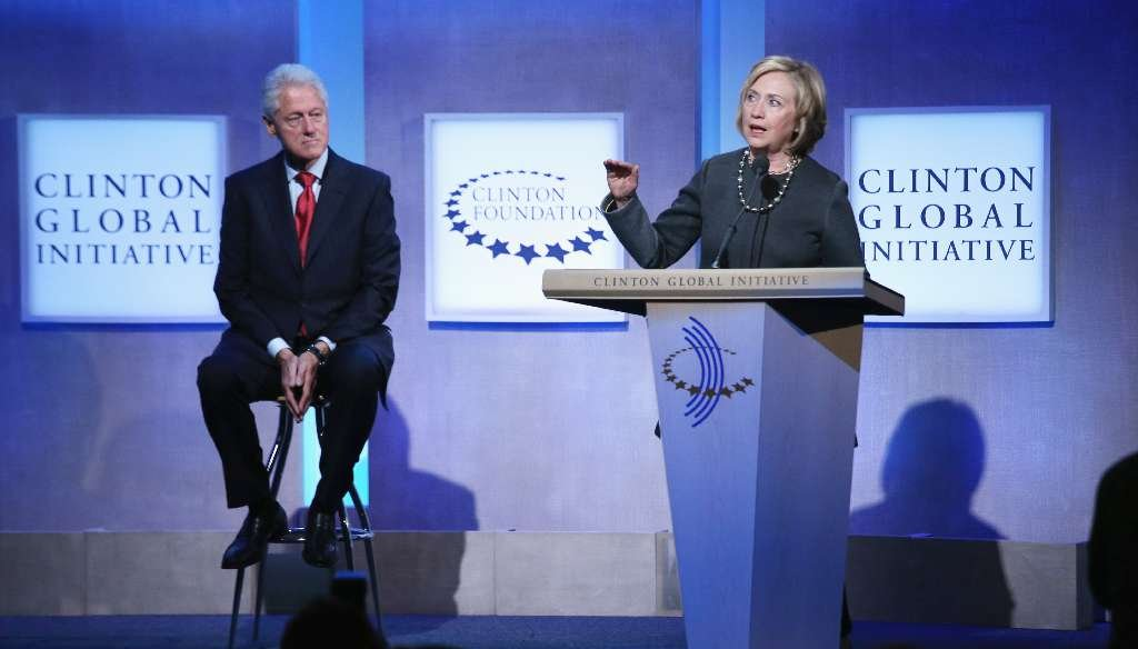 Former U.S. Secretary of State Hillary Clinton (R) speaks as former U.S. President Bill Clinton looks on during the opening plenary session of the Clinton Global Initiative (CGI), on September 22, 2014 in New York City. (John Moore/Getty Images)