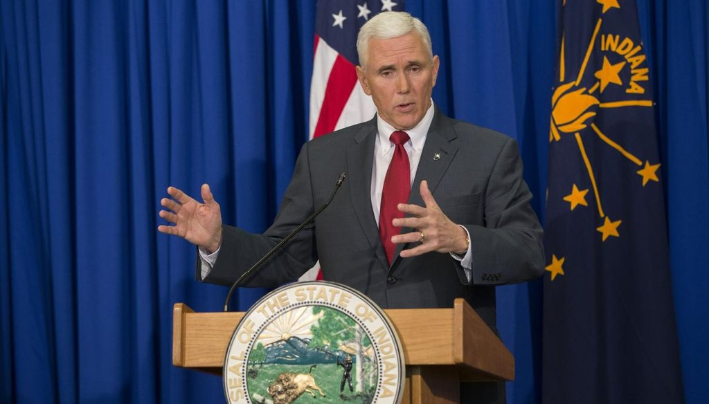 Indiana Gov. Mike Pence speaks during a press conference March 31 at the Indiana State Library in Indianapolis. (Getty)