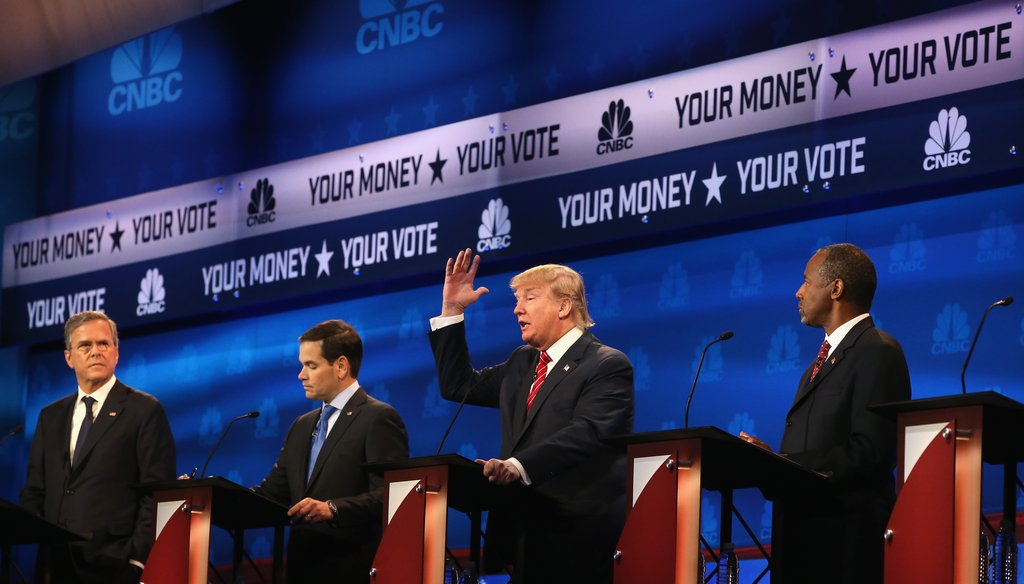 Donald Trump speaks as Jeb Bush, Marco Rubio, and Ben Carson look on during the CNBC Republican presidential debate on Oct. 28, 2015. (AP Photo)