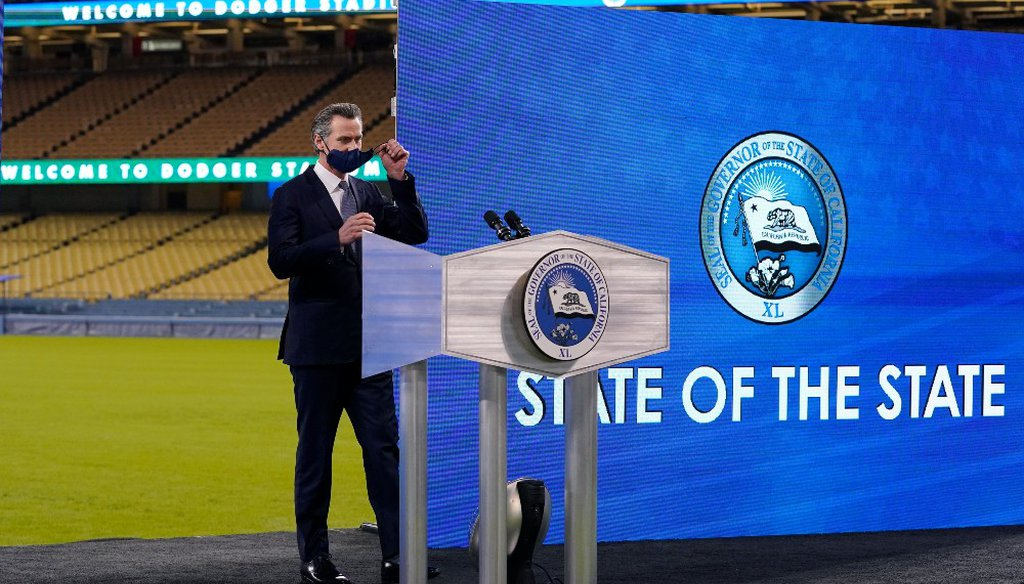 California Gov. Gavin Newsom takes his mask off before to delivering his State of the State address from Dodger Stadium Tuesday, March 9, 2021, in Los Angeles. (AP Photo/Mark J. Terrill)