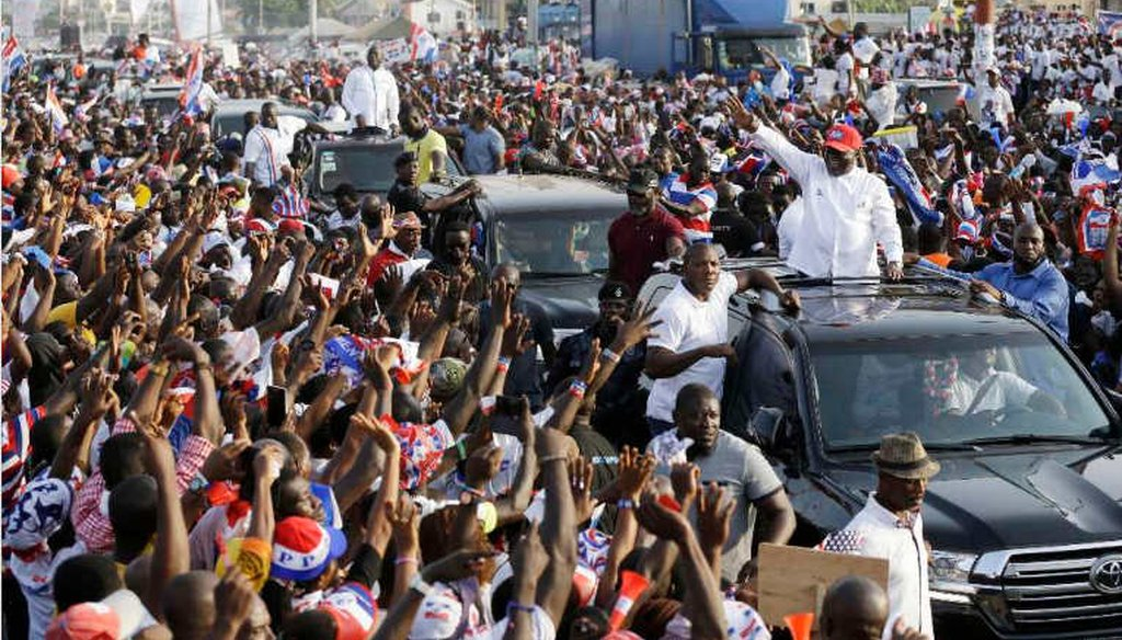 Nana Akufo-Addo, presidential candidate of the opposition New Patriotic Party waves to his supporters at a rally in Accra, Ghana, shortly before winning the election. (AP)