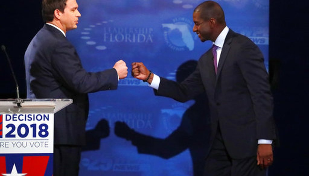 Florida gubernatorial candidates, Republican Ron DeSantis, left, and Democrat Andrew Gillum fist bump after a debate, Wednesday, Oct. 24, 2018, at Broward College in Davie, Fla. (AP)
