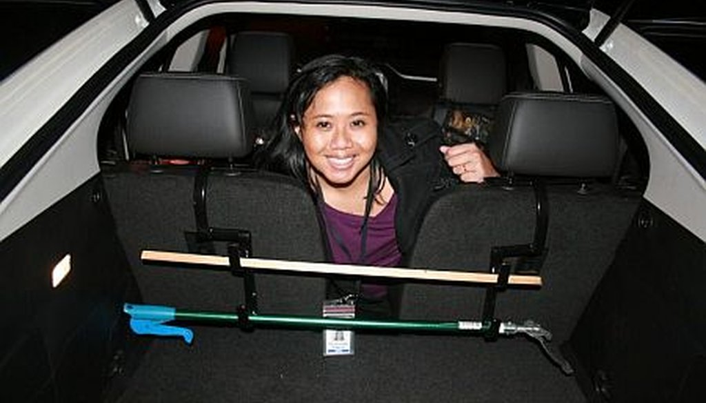 PolitiFact Georgia reporter Willoughby Mariano shows off a gun rack she installed in a Chevy Volt.
