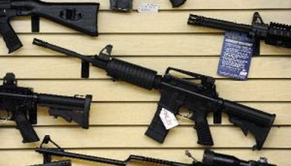 Guns, including an AR-15 semi-automatic rifle, for sale at a shop in Pasadena, Maryland, Jan. 14, 2013.
