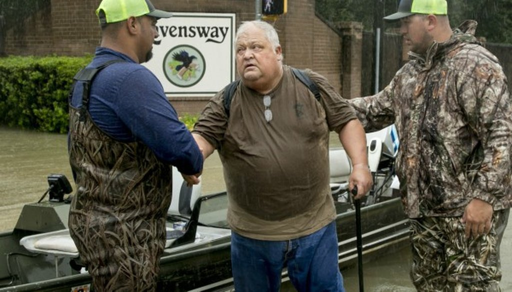 David Emswiler thanks the men rescuing him from his flooded house in Northwest Houston on Aug. 28, 2017. Later, four members of the Texas congressional delegation voted against a plan including hurricane aid (PHOTO: Jay Janner, AUSTIN AMERICAN-STATESMAN).