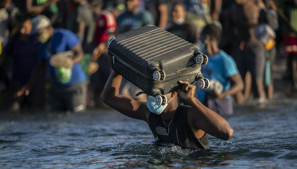 Migrants, many from Haiti, wade across the Rio Grande from Del Rio, Texas, to return to Mexico, Sept. 20, 2021, to avoid deportation from the U.S. (AP)