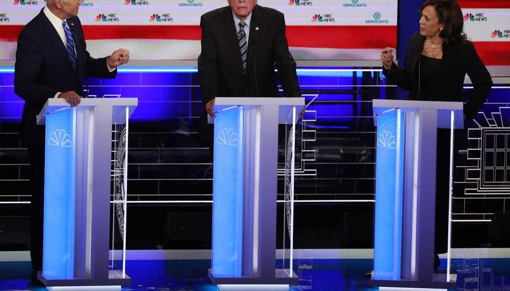 Democratic presidential candidate and  former Vice-President Joe Biden, left, and Sen. Kamala Harris, D-Calif., spar during the Democratic primary debate in Miami. Sen. Bernie Sanders, I-Vt., is in the center. (AP Photo/Wilfredo Lee)