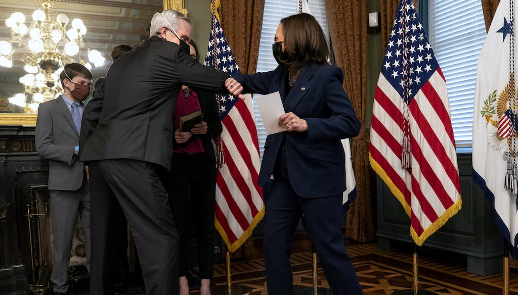 Vice President Kamala Harris, right, and Denis McDonough bump elbows after McDunough was ceremonially sworn in by Harris as secretary of Veterans Affairs, Feb. 9, in Washington. Social media posts falsely claim she said she will close the department. (AP)