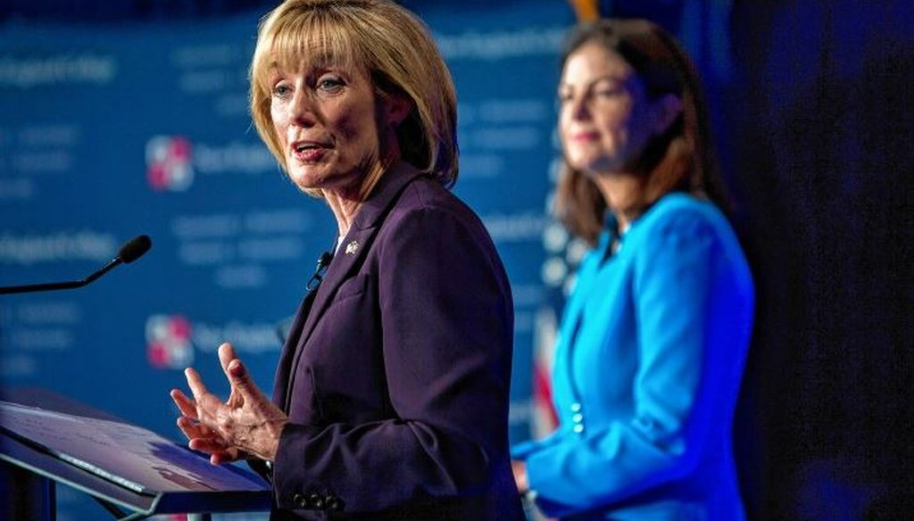 Gov. Maggie Hassan answers a question as Sen. Kelly Ayotte looks on at New England College. GEOFF FORESTER / Concord Monitor