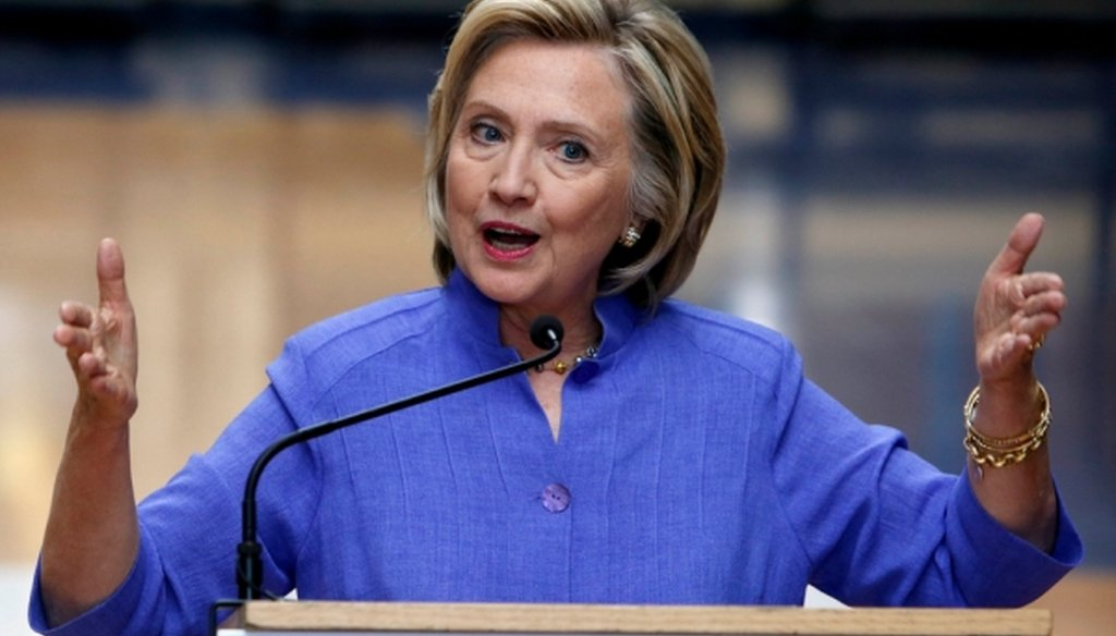 Democratic presidential candidate Hillary Clinton answers reporters' questions after announcing her college affordability plan in Exeter, N.H., on Aug. 10, 2015. (AP/Jim Cole)