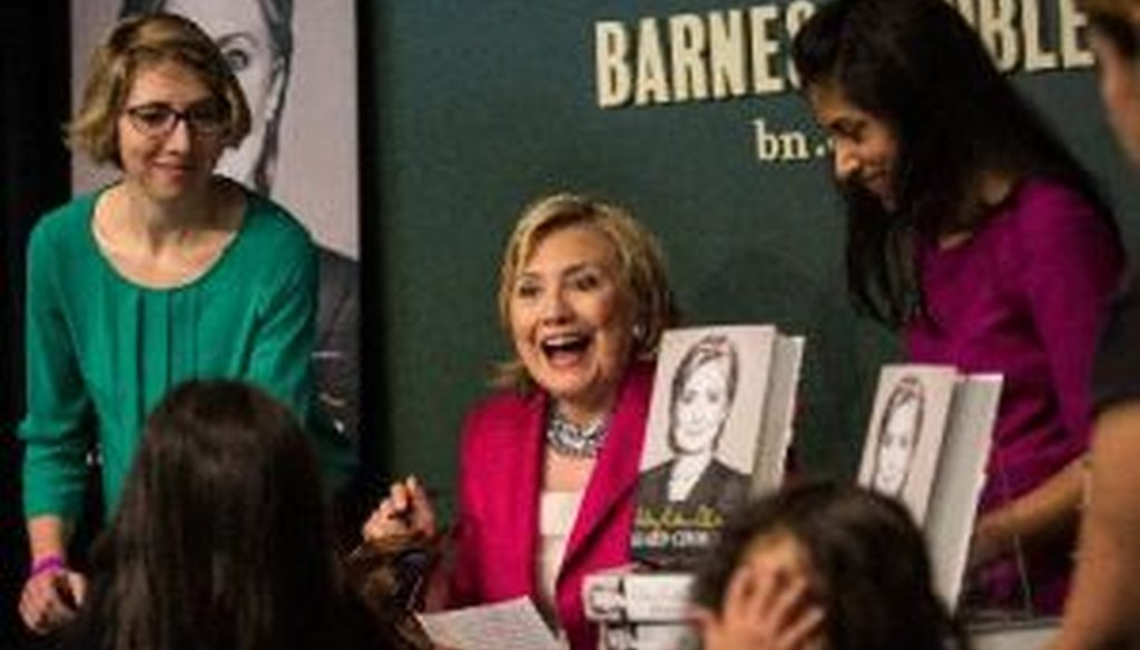"""Former Secretary of State Hillary Clinton signs her new book, """"Hard Choices,"""" June 10, 2014, in New York City."""