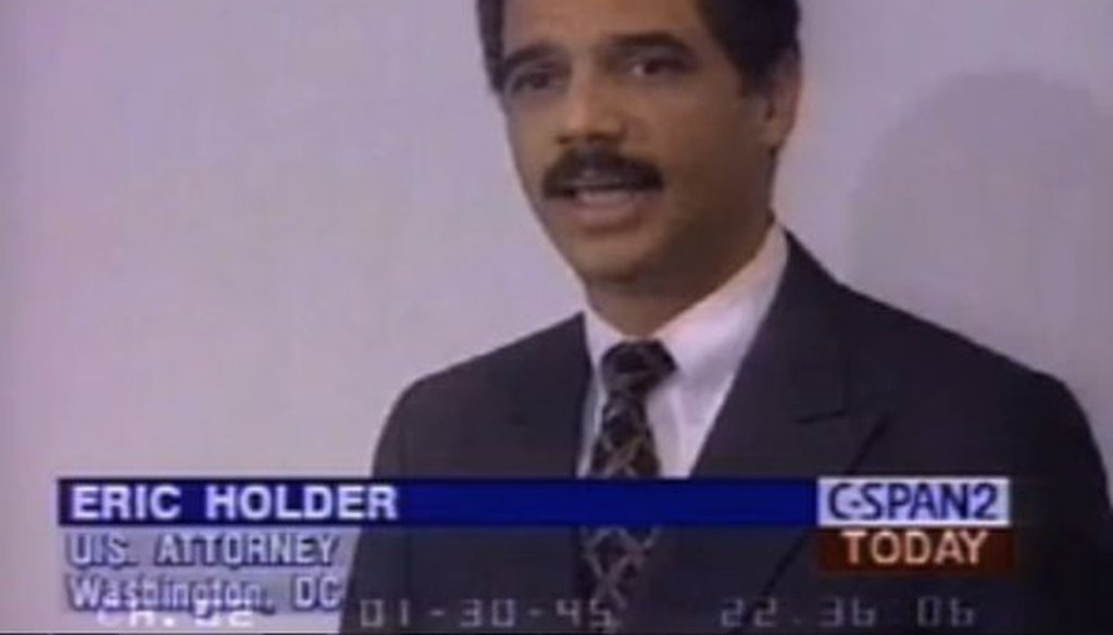 This is a screenshot from a video of a 1995 speech by Eric Holder, the future attorney general.
