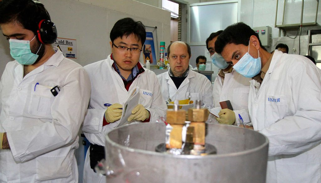 International Atomic Energy Agency inspectors and Iranian technicians stop a uranium enrichment process at the Natanz facility, Jan. 20, 2014 (AP)
