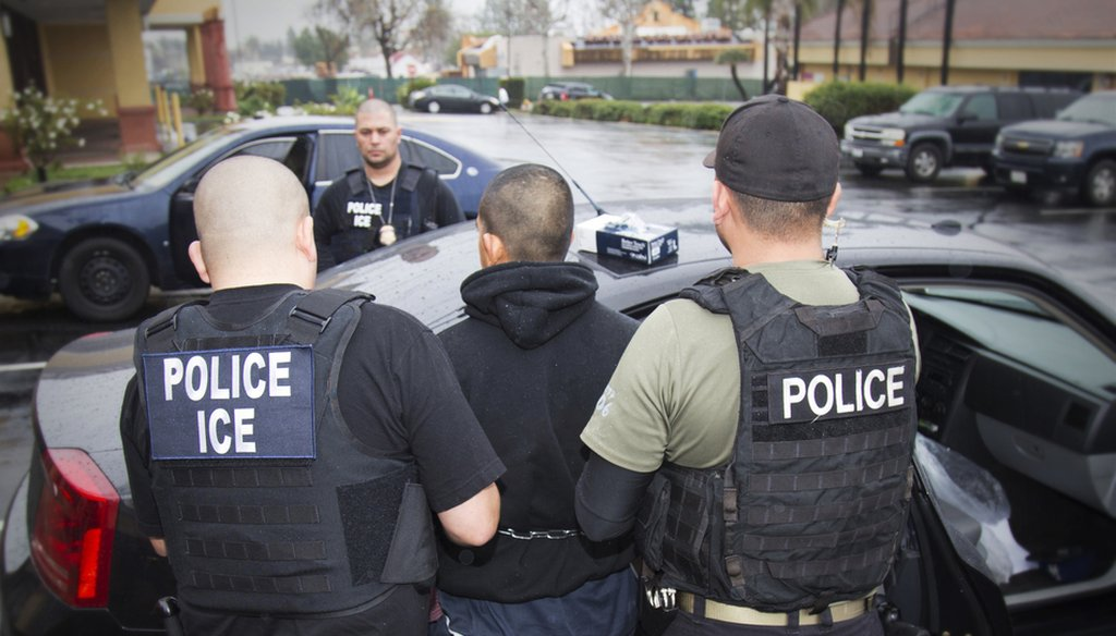 A photo released in February 2017 by U.S. Immigration and Customs Enforcement shows people being arrested during an ICE operation.