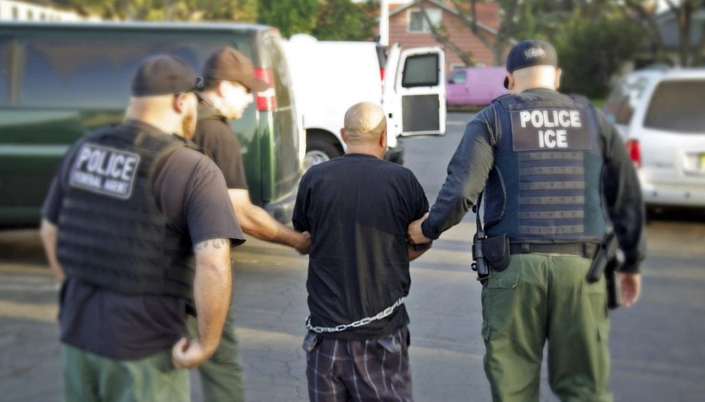 U.S. Bureau of Immigration and Customs Enforcement agents lead a man into custody during an immigration sweep in Ontario, Calif., in October 2014. (AP/U.S. Bureau of Immigration and Customs Enforcement)