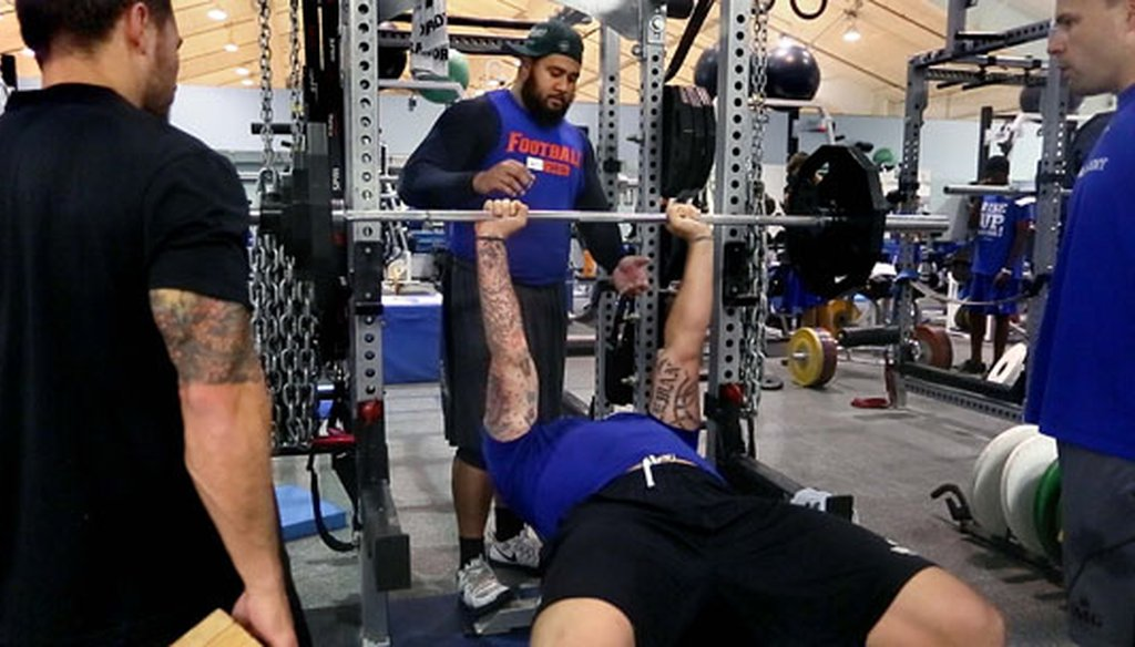 Jon Halapio, a guard for the Denver Broncos, spots Taylor Lewan, offensive tackle for the Tennessee Titans at IMG Academy in Bradenton while trainers watch on March 26, 2015. (Times file photo)
