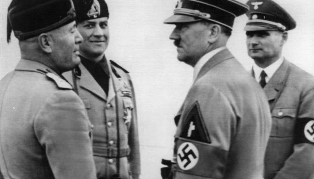 Adolf Hitler, right foreground, and Italy's Benito Mussolini, left are shown during a Hitler visit in Italy in 1938. Italy's Foreign Minister Count Galeazzo Ciano, and Hitler's Deputy Rudolf Hess behind. (AP)