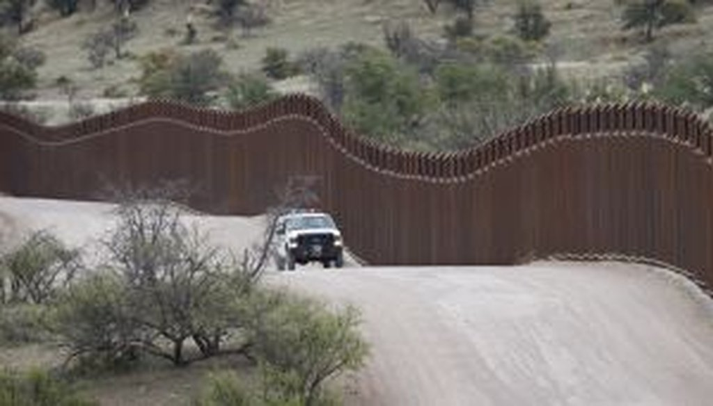 A border patrol agent monitors the international border in Arizona.
